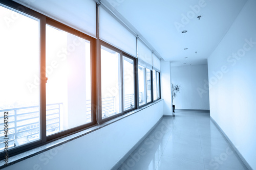 Obraz na plátně Empty long corridor in modern office building