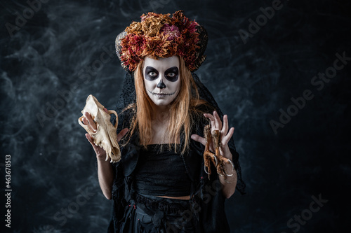 Canvastavla red-haired woman in Halloween costume, witch make-up with horns and dried flower
