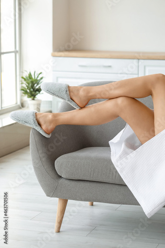 Young woman with beautiful legs relaxing at home