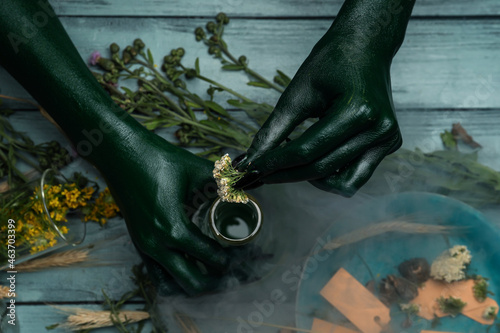 Fotografie, Obraz Witch making potion at table