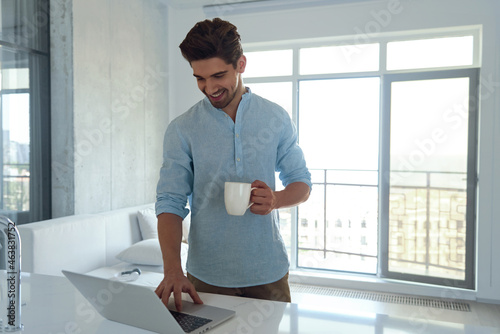 Caucasian man using laptop at home office