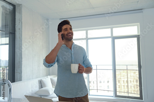 Caucasian man using smartphone at home office