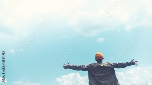 Canvastavla Copy space of man rising hands on blue sky white clouds abstract background