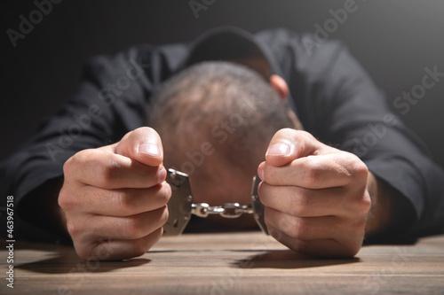 Murais de parede Caucasian man in handcuffs. Arrest