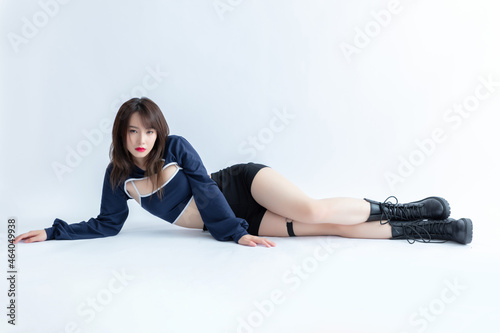 Fototapeta Attractive woman wearing camisole and shorts