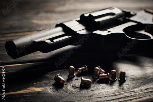 Fototapeta Revolver pistol with Flobert ammo 4mm on dark wooden background