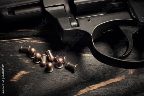 Obraz na plátně Revolver pistol with Flobert ammo 4mm on dark wooden background
