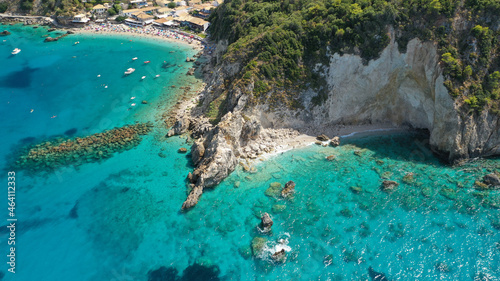 Fotografiet Aerial drone photo of small rocky cove near popular traditional village of Agios