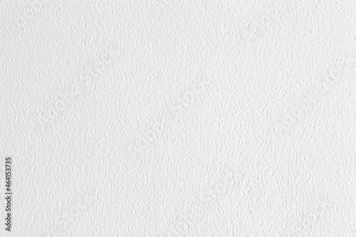 Fotografiet Old cement wall outside the building, painted white, smooth surface texture and