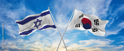 Photo crossed national flags of Israel and south korea  flag waving in the wind at cloudy sky