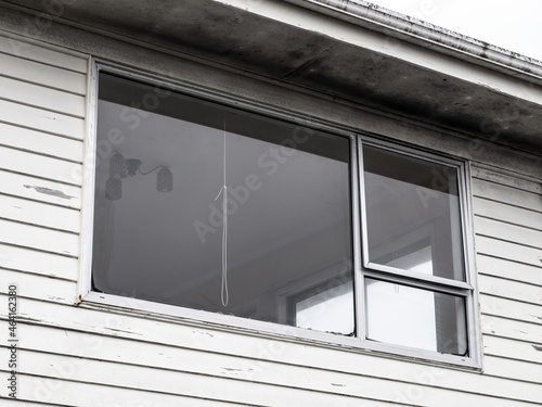 Canvas Print Typical window with aluminum frame on weatherboard wall