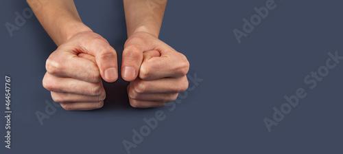 Obraz na plátně Male fists on the background.