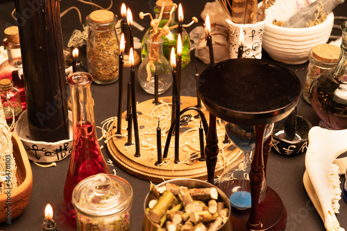Fotografie, Obraz Witchcraft still life with black burning candles selective focus