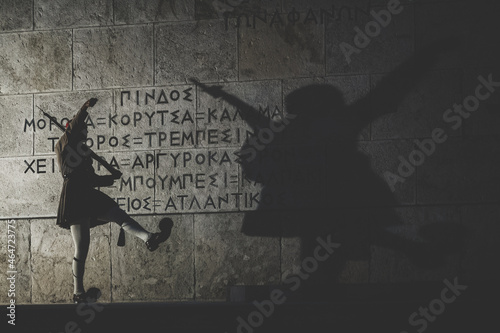 Slika na platnu Silhouette of a guardian and his shade on an ancient wall with a greek note
