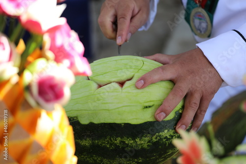 Canvas Print Pumpkin and some vegetables carved with carving knife to get flower design